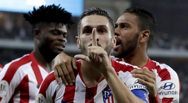 Atletico Madrid booked their place in the final of the Spanish Super Cup with a 3-2 victory against Barcelona (Hassan Ammar/AP)