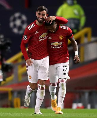 Manchester United's Bruno Fernandes (left) celebrates scoring his side's first goal of the game with team-mate Fred (Martin Rickett/PA)