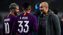 City slickers: Pep Guardiola celebrates with his strikers Sergio Aguero and Gabriel Jesus