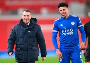 Job done: James Justin is all smiles with Leicester City boss Brendan Rodgers on Saturday