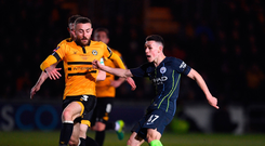 Young gun: Phil Foden fires home his second goal in Saturday night's win