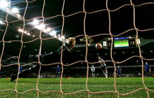 On the spot: Harry Kane strokes his penalty past Kasper Schmeichel in the Leicester goal to earn Spurs a replay