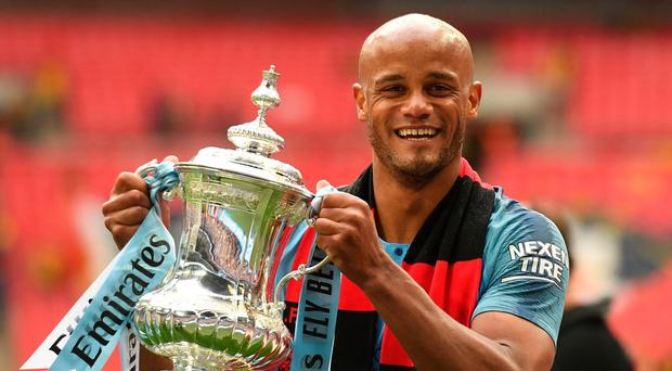 All smiles: Vincent Kompany shows off the FA Cup
