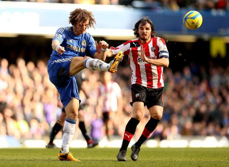 LONDON, ENGLAND - FEBRUARY 17: David Luiz of Chelsea (L) in action with Jonathan Douglas of Brentford during the FA Cup Fourth Round Replay between Chelsea and Brentford at Stamford Bridge on February 17, 2013 in London, England. (Photo by Scott Heavey/Getty Images)