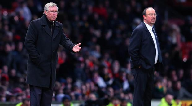 MANCHESTER, ENGLAND - MARCH 10: Manchester United Manager Sir Alex Ferguson gestures as Chelsea Interim Manager Rafael Benitez (r) looks on during the FA Cup sponsored by Budweiser Sixth Round match between Manchester United and Chelsea at Old Trafford on March 10, 2013 in Manchester, England. (Photo by Alex Livesey/Getty Images)