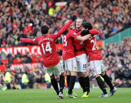 Manchester United's Wayne Rooney (second right) celebrates scoring his side's second goal of the game against Chelsea with teammates during the FA Cup Quarter Final match at Old Trafford, Manchester