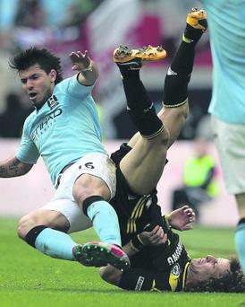 Manchester City's Sergio Aguero challenges Chelsea's David Luiz but no foul is awarded during the FA Cup, Semi Final at Wembley Stadium, London. PRESS ASSOCIATION Photo. Picture date: Sunday April 14, 2013.