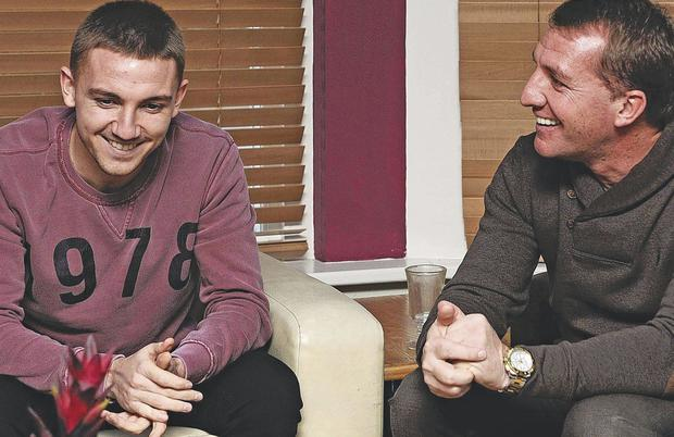 Fatherly advice: Brendan Rodgers gets together with his son Anton ahead of their FA Cup tie