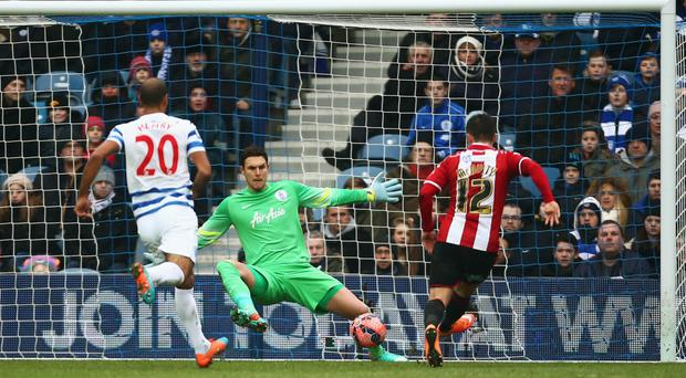 Cool head: Marc McNulty calmly fires past Alex McCarthy in the QPR goal to put Sheffield United ahead
