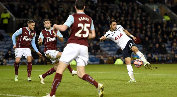 Deadlock broken: Spurs ace Nacer Chadli opens the scoring against Burnley at Turf Moor with a deflected strike