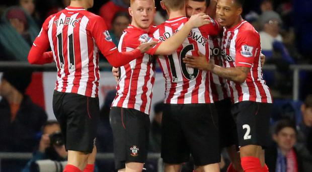 Decisive moment: Southampton stars mob goalscorer Shane Long after he scored the only goal against Ipswich