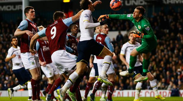Keeping cool: Vlad Chiriches pounces to head Tottenham into the lead after Burnley keeper Tom Heaton's flap