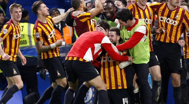 Bradford players celebrate after knocking Chelsea out of the FA Cup on Saturday