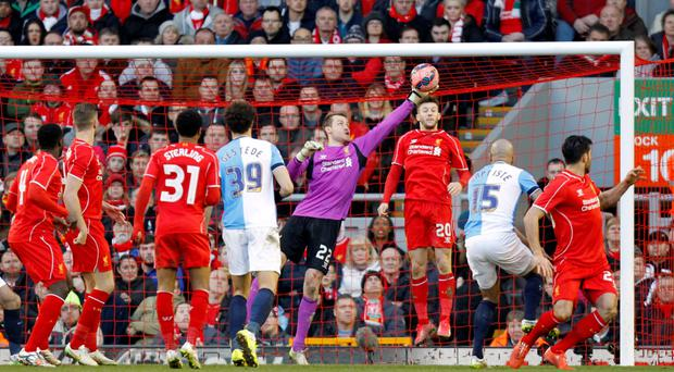Top stop: Liverpool keeper Simon Mignolet makes a superb save from Blackburn Rovers' Alex Baptiste (second right)