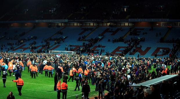 Over the fence: fans invade the Villa Park pitch following Aston Villa's FA Cup quarter-final win over West Brom