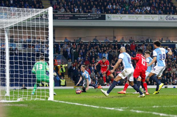 Perfect finish: Liverpool's Philippe Coutinho scores his side's winner against Blackburn Rovers