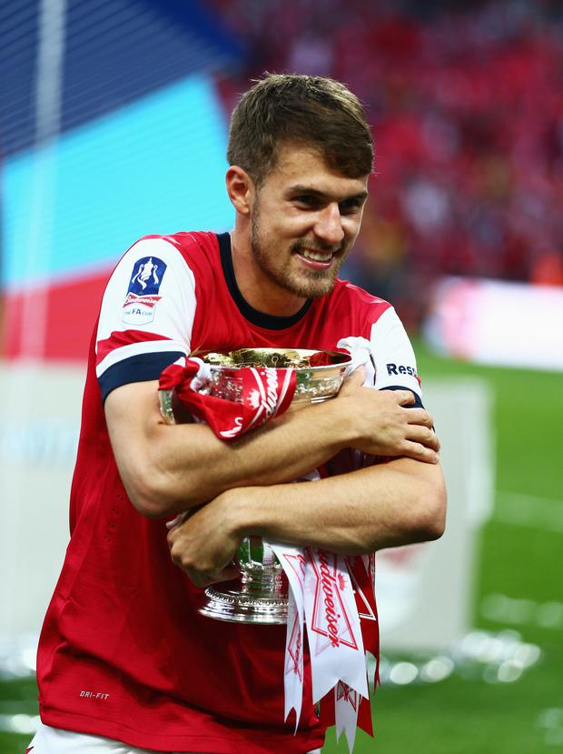 Prize guy: Aaron Ramsey with the FA Cup after last year's win