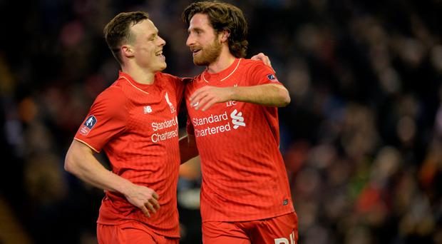 Go Joe: Joe Allen celebrates with Brad Smith after scoring Liverpool's opening goal last night at Anfield