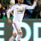 Take that: Juan Mata celebrates after firing home United's second goal direct from a free-kick