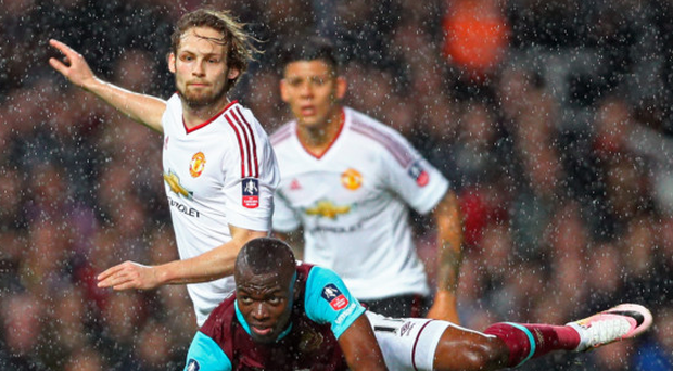 Battle: Manchester United's Daley Blind challenges West Ham's Enner Valencia at Upton Park last night