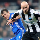 Battle lines: Jonjo Shelvey fends off Robert Tesche