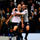 Late show: Son Heung-min celebrates his winning goal with Vincent Janssen
