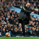 For kicks: Man City boss Pep Guardiola is aiming for FA Cup glory