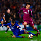 Leroy Sane of Manchester City is tackled by Joe Bennett of Cardiff City