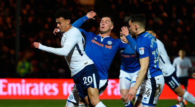 Talking point: Dele Alli takes a tumble under a challenge from Rochdale's Harrison McGahey