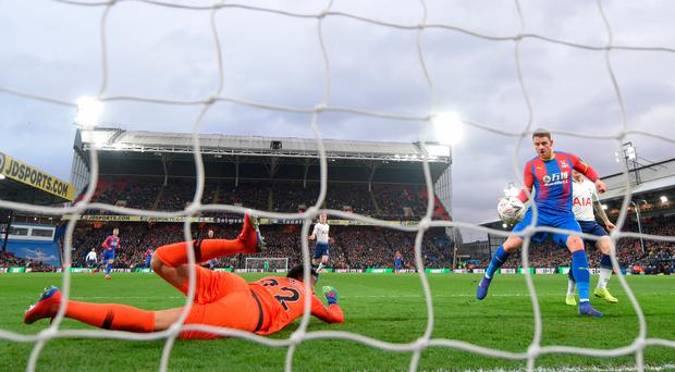 Simple finish: Spurs keeper Paulo Gazzaniga is powerless to prevent Connor Wickham from putting Palace in front