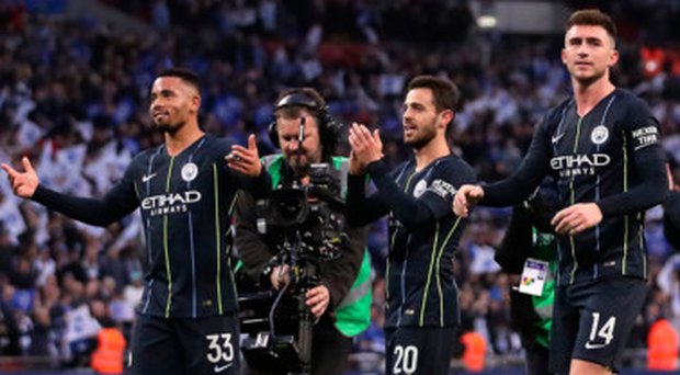 City slickers: Gabriel Jesus (left) leads the plaudits after the final whistle