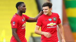 Manchester United are looking forward to the FA Cup semi-finals after Harry Maguire, right, scored a late winner against Norwich (Catherine Ivill/NMC Pool/PA)