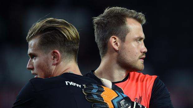 Simon Mignolet (right) will offer fellow Liverpool goalkeeper Loris Karius all the support he needs after his Champions League nightmare.