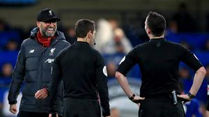 Liverpool manager Jurgen Klopp (left) could still smile when speaking to referee Chris Kavanagh after the FA Cup loss at Chelsea (Mike Egerton/PA)