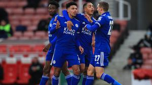 Leicester City's James Justin (centre) celebrates scoring his side's first goal of the game with team-mates Youri Tielemans and Onyinye Ndidi (left) and Timothy Castagne (right) during the Emirates FA Cup third round match at the bet365 Stadium, Stoke.