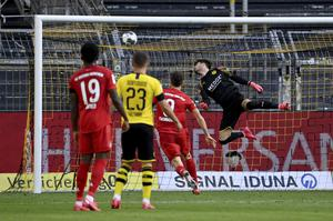 Dortmund goalkeeper Roman Burki is beaten by Joshua Kimmich (Federico Gambarini/POOL)