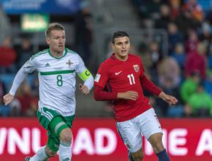 Looking back: Steven Davis in action against Norway, but their September battle at Windsor could go ahead behind closed doors