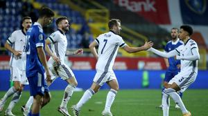 Major say: Niall McGinn is congratulated after netting Northern Ireland's equaliser against Bosnia in Sarajevo