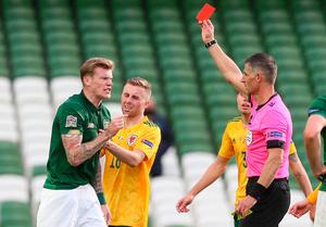 Off colour: James McClean protests his dismissal