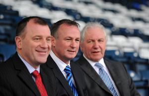 Golden chapter: then Irish FA president Jim Shaw (right) and chief executive Patrick Nelson (left) welcome Michael O'Neill to the Northern Ireland job