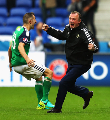 Pure joy: Aaron Hughes and Michael O'Neill celebrate Northern Ireland's second goal in the win over Ukraine at Euro 2016