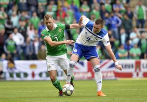 No fear: Northern Ireland's Niall McGinn tackles Bosnia & Herzegovina's Haris Duljevic in their first Nations League clash