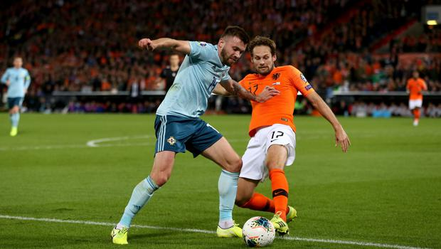 Man on: Netherlands' Daley Blind closes in on Stuart Dallas