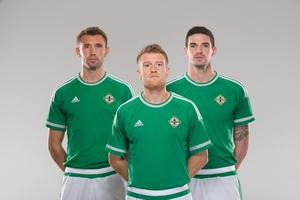 Men in green: Gareth McAuley, Steven Davis and Kyle Lafferty stand proud in the new Northern Ireland kit