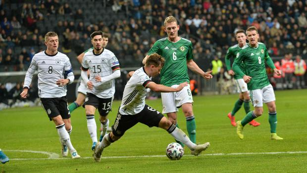 Cut out: Northern Ireland midfielder George Saville does battle with Germany ace Joshua Kimmich in Frankfurt