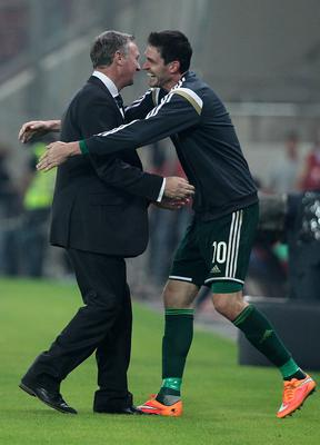 On the up: Michael O'Neill and Kyle Lafferty celebrate in Greece