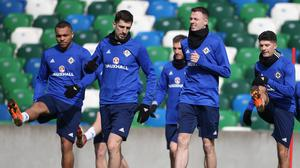 Dependable performers: Craig Cathcart and Jonny Evans (centre) are certs to be partnered in Northern Ireland's defensive line