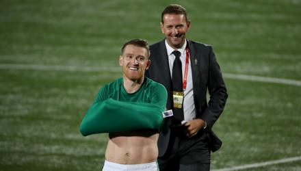 Steven Davis and Ian Baraclough af the final whistle after Northern Ireland's victory in Lithuania