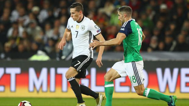 Close watch: Aaron Hughes tracks Germany ace Julian Draxler in Hannover in 2016