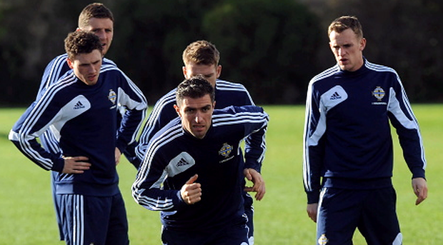 Former Northern Ireland captain Aaron Hughes (centre) leads the players in training